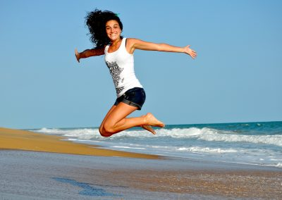 Image of a lady jumping in the air demonstrating the physical benefits one can get from Chiropractic, Osteopathy, Massage Therapy, Acupuncture and Floatation therapy.
