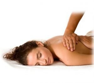 A lady receiving a therapeutic massage at County chiropractic in Exeter