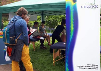 County Chiropractic Osteopath Adam and Massage Therapy team member Vanessa conducting health checks at Exeter Pride