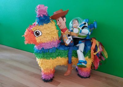 Best Buds, buzz and woody on their way to infinity and beyond riding on the back of rainbow coloured donkey