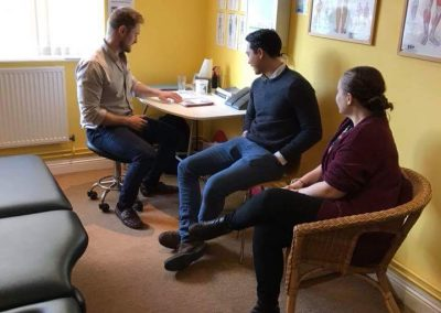 Chiropractor Tom with a client at county chiropractic clinic in exeter