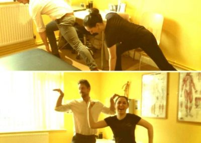 Chiropractor Tom and massage therapist stretching and showing off their swans