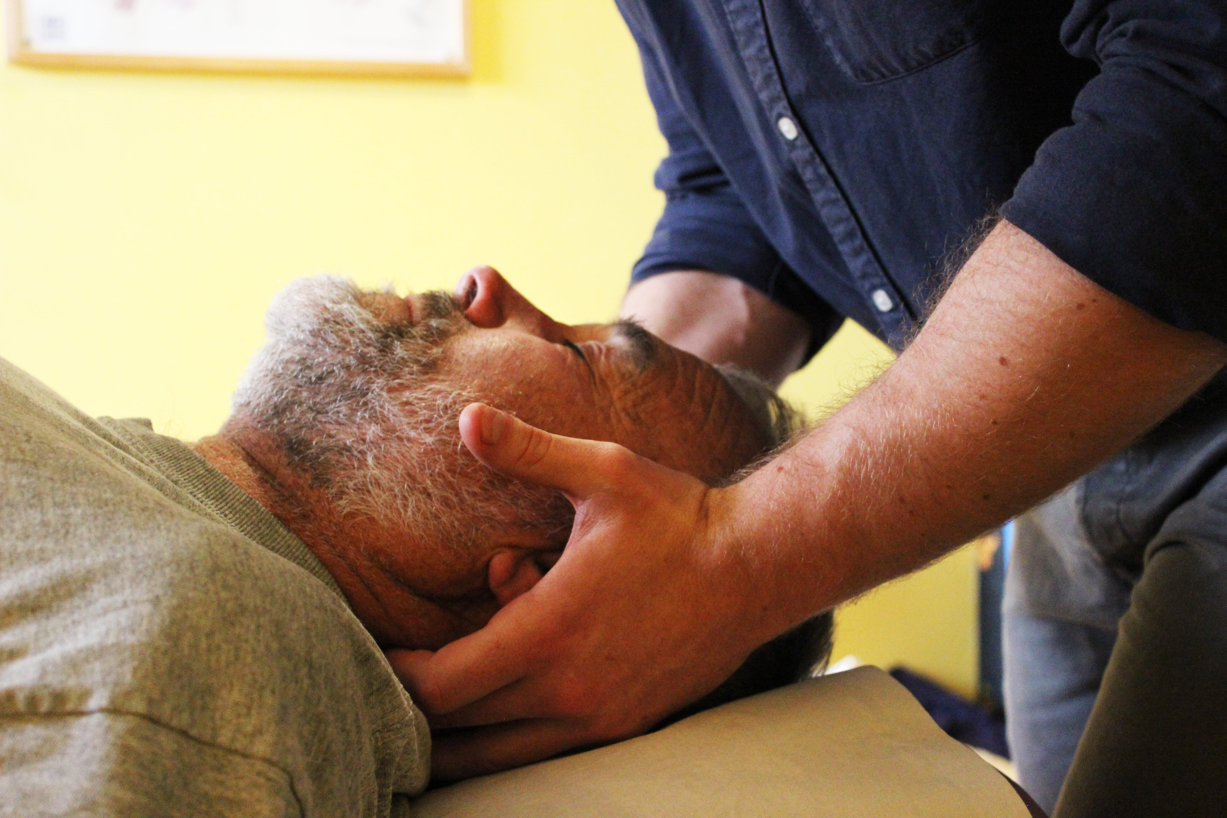 Image of Osteopath Adam Robertson performing a neck pain or neck ache assessment at County Chiropractic Exeter